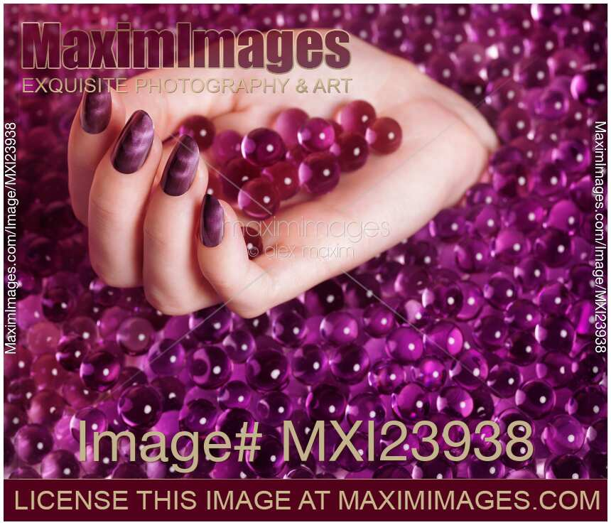 Nail Polish Colors For Younger Looking Hands: Stock Photo: Abstract Woman Hand With Purple Nail Polish