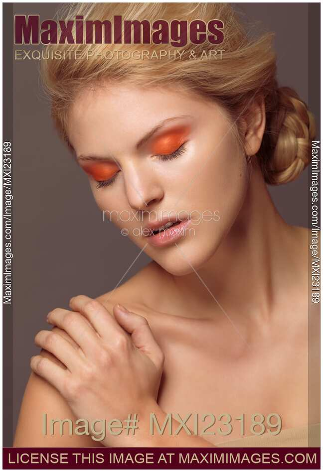 Stock photo: Beautiful Young Woman with Orange Eyeshadow ...