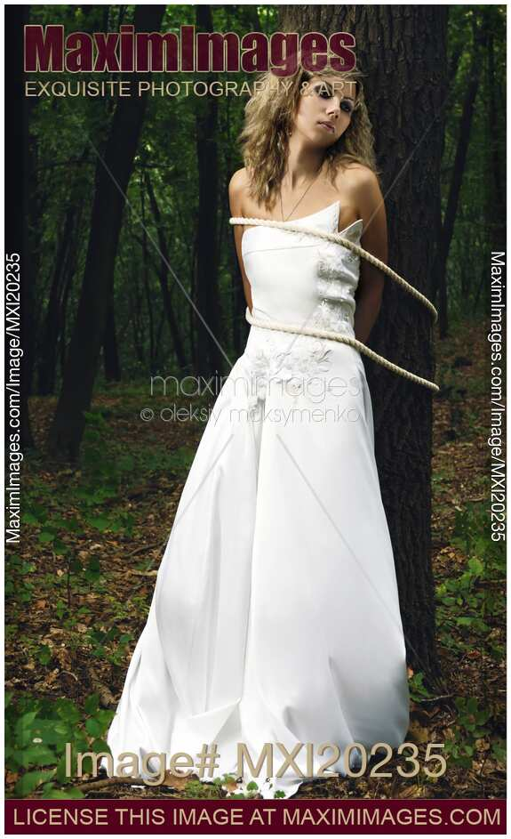 Stock photo: Bride Tied to a Tree in a Forest | MaximImages | Image ...