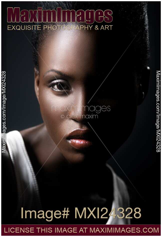 Stock Photo Dramatic Portrait Of A Young African Woman