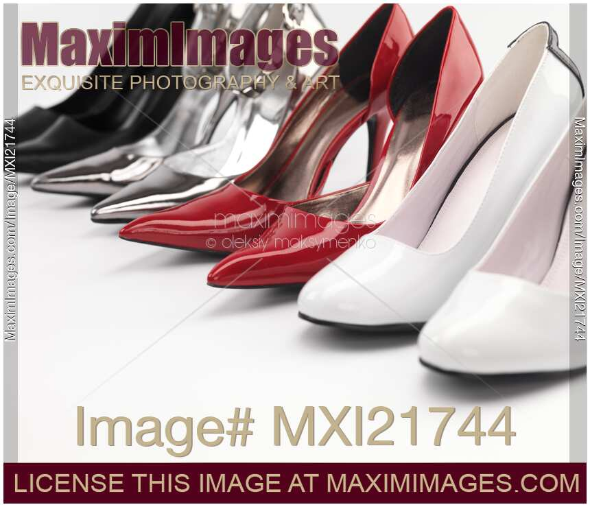 d623388e4e Four pairs of fashionable high heel stiletto shoes on white background