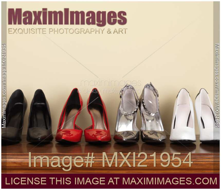f214994eca Four pairs of fashionable high heel stiletto shoes on a shelf