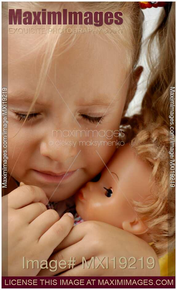 Stock Photo Crying Little Girl Holding Doll Maximimages