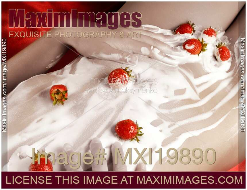 Stock photo of Sexy Naked Woman Body Covered with Cream and Strawberries