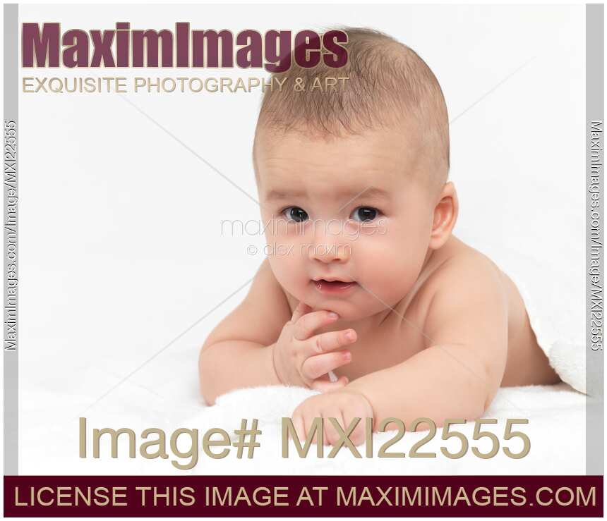 Stock photo of portrait of a four month old baby boy looking at the