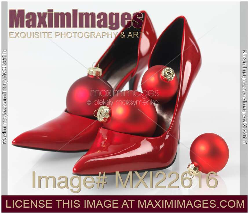 Stock photo christmas ornament in red high heels shoes