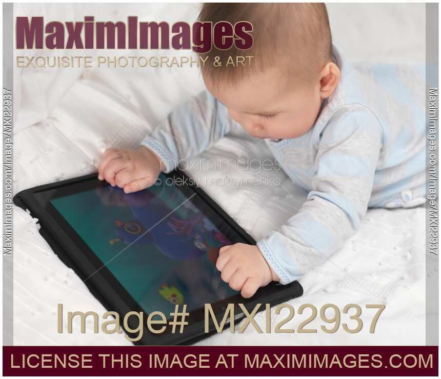 Baby boy playing with apple ipad tablet computer keywords ipad baby