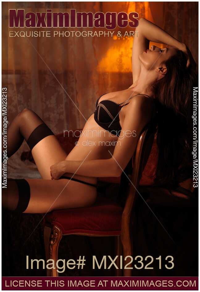 Are hot girl sitting in chair