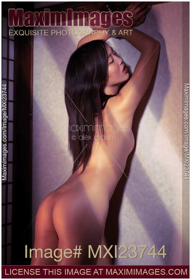 Stock Of Asian Woman Standing Naked At A Wall With Tied Hands
