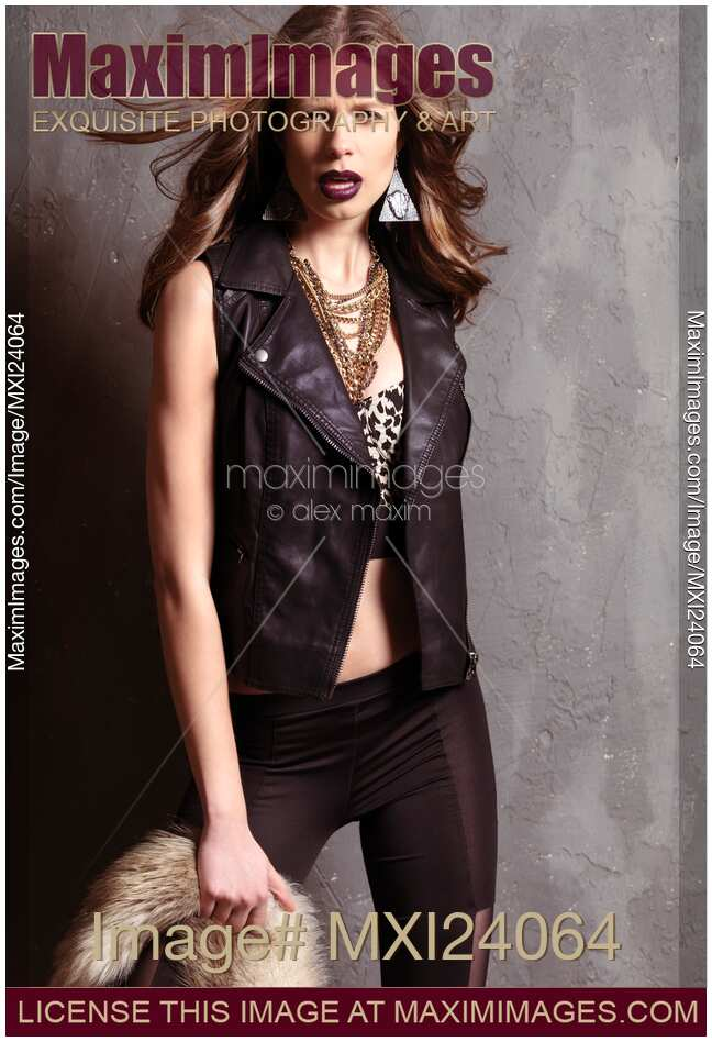 of Edgy fashion photo of a young woman wearing 1990s grunge fashion