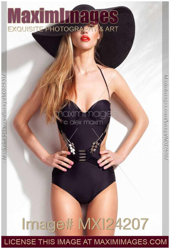 photo of Beautiful young woman wearing a one-piece monokini swimsuit