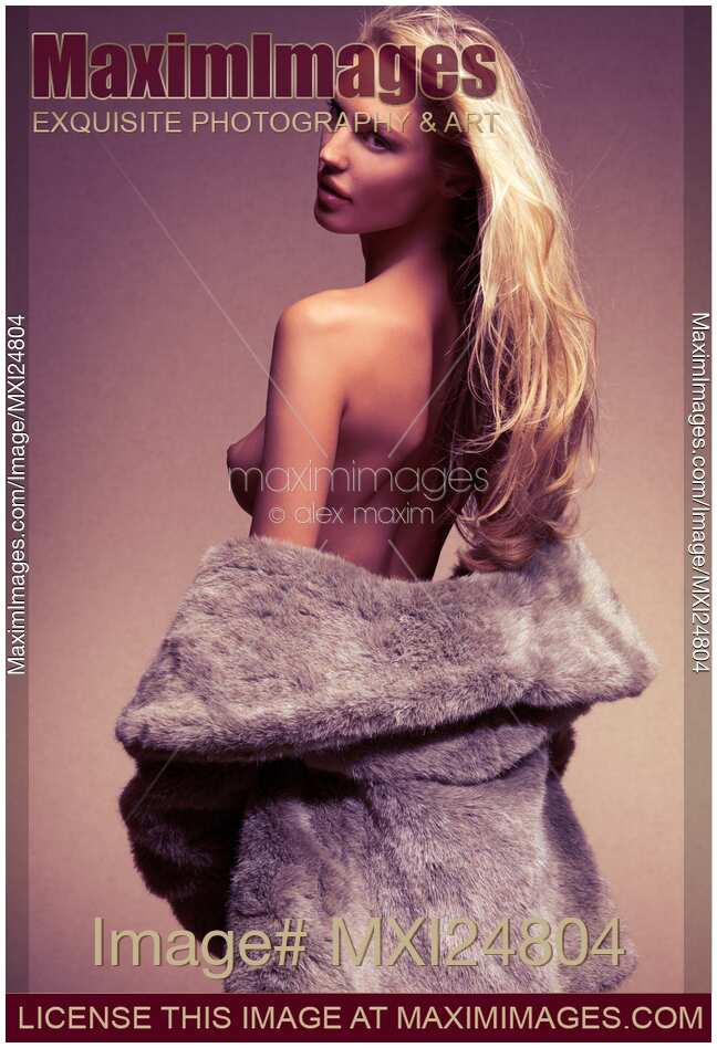 Stock photo of Beautiful sexy woman in fur coat over naked body