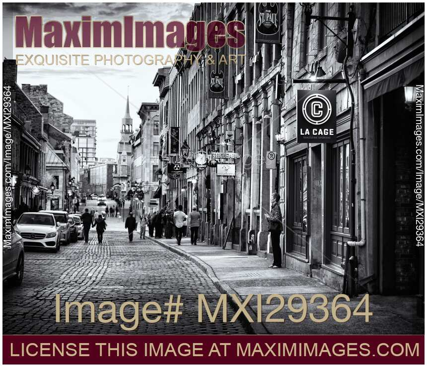 Stock photo of people walking on rue saint paul historic street of old town in montreal quebec black and white