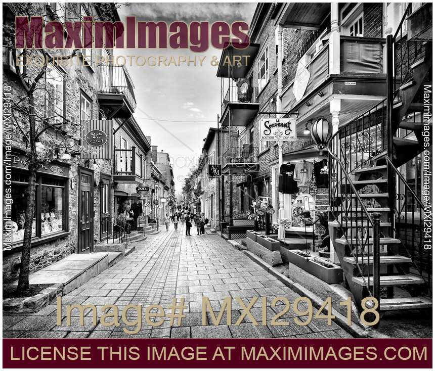 Stock photo of rue du petit champlain colorful store displays of old quebec city black and white