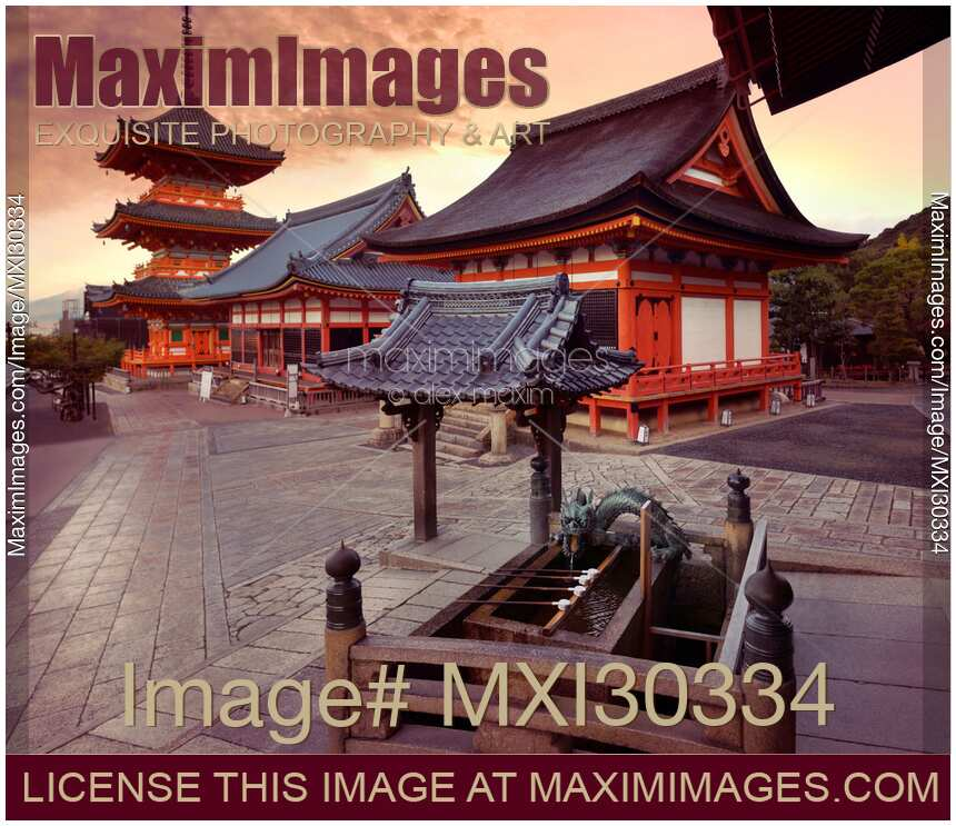 Colorful sunrise scenery of Kiyomizu-dera Buddhist temple buildings and Chozubachi water ablution pavilion basin Kyoto Japan