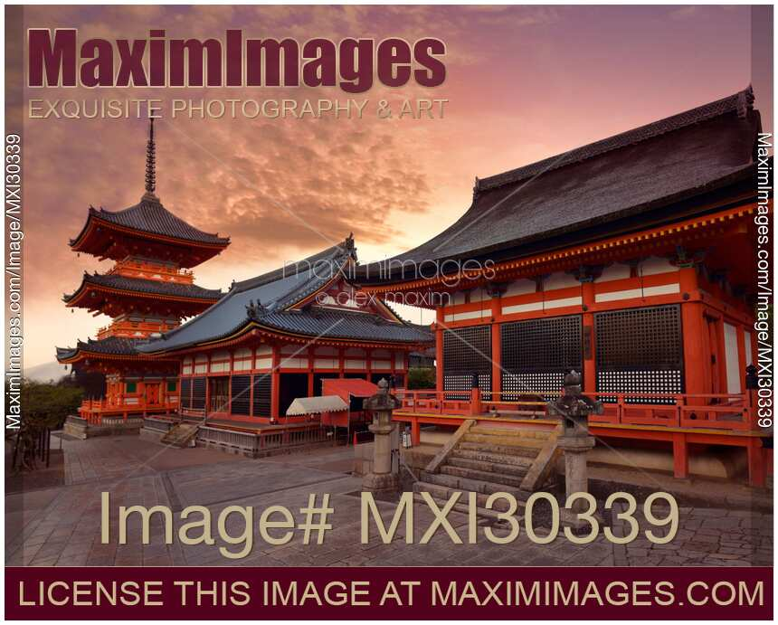 Sanjunoto pagoda Kaisan-do and Kyo-do hall at Kiyomizu-dera Buddhist temple Kyoto in dramatic red sunrise