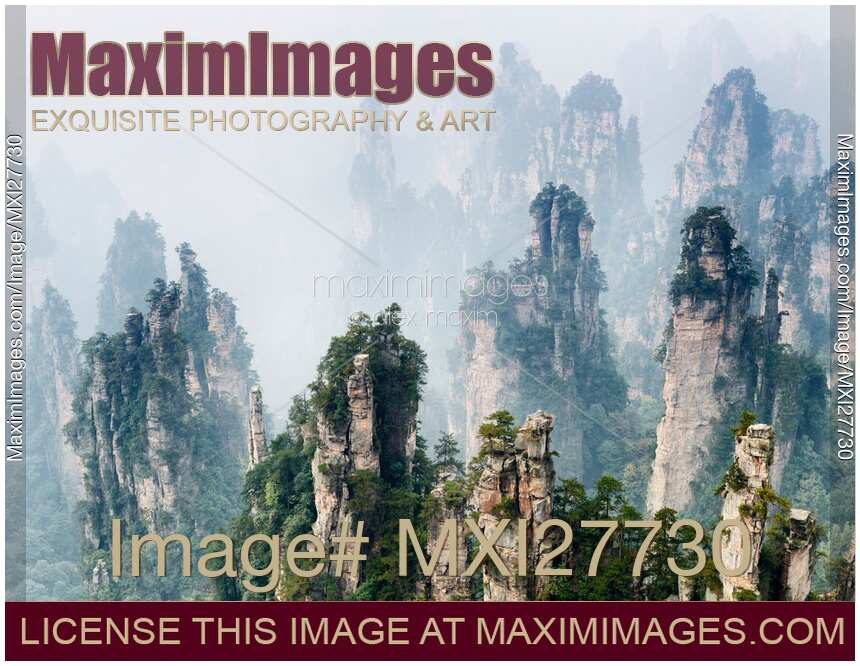 Photo of Mountain spires rising from fog at Zhangjiajie National Forest Park