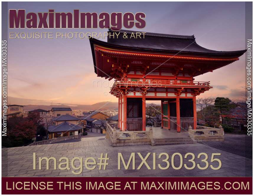 Photo of Nio-mon gate of Kiyomizu-dera Buddhist temple at sunrise and Kyoto city landscape