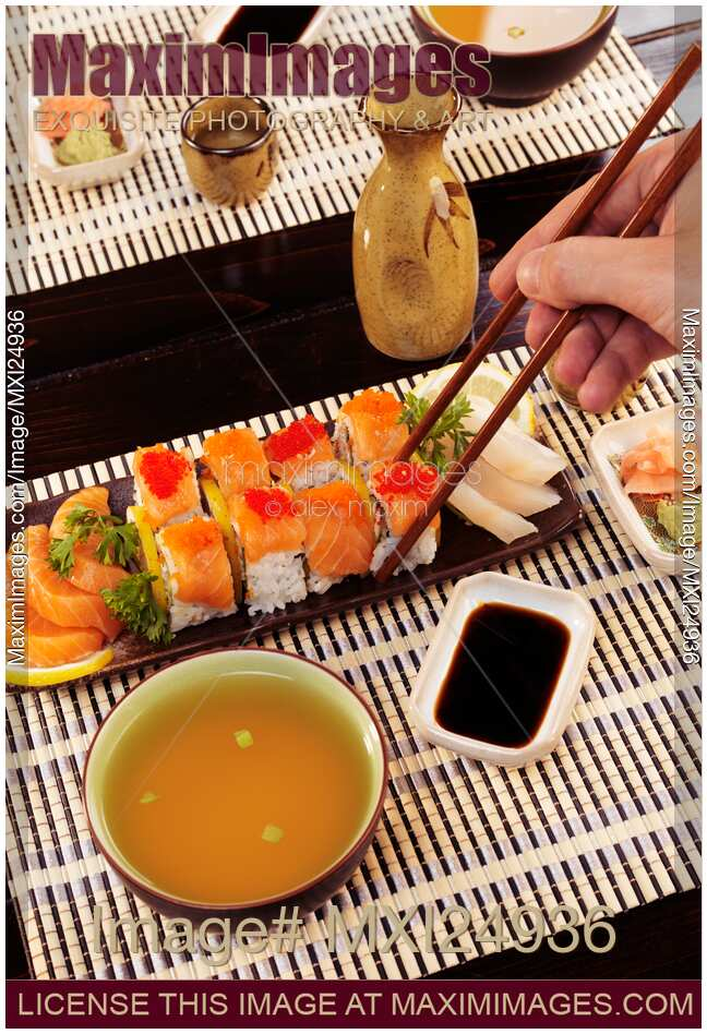 stock photo person eating sushi at japanese restaurant. Black Bedroom Furniture Sets. Home Design Ideas