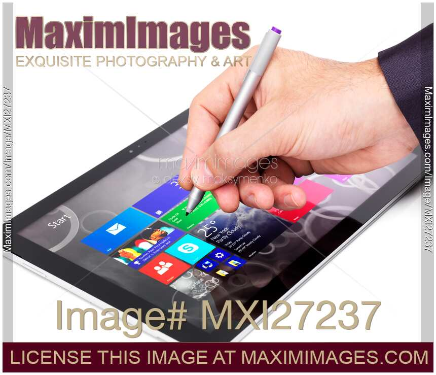 Photo of Person using Microsoft tablet Surface Pro 3 | Stock Image MXI27237