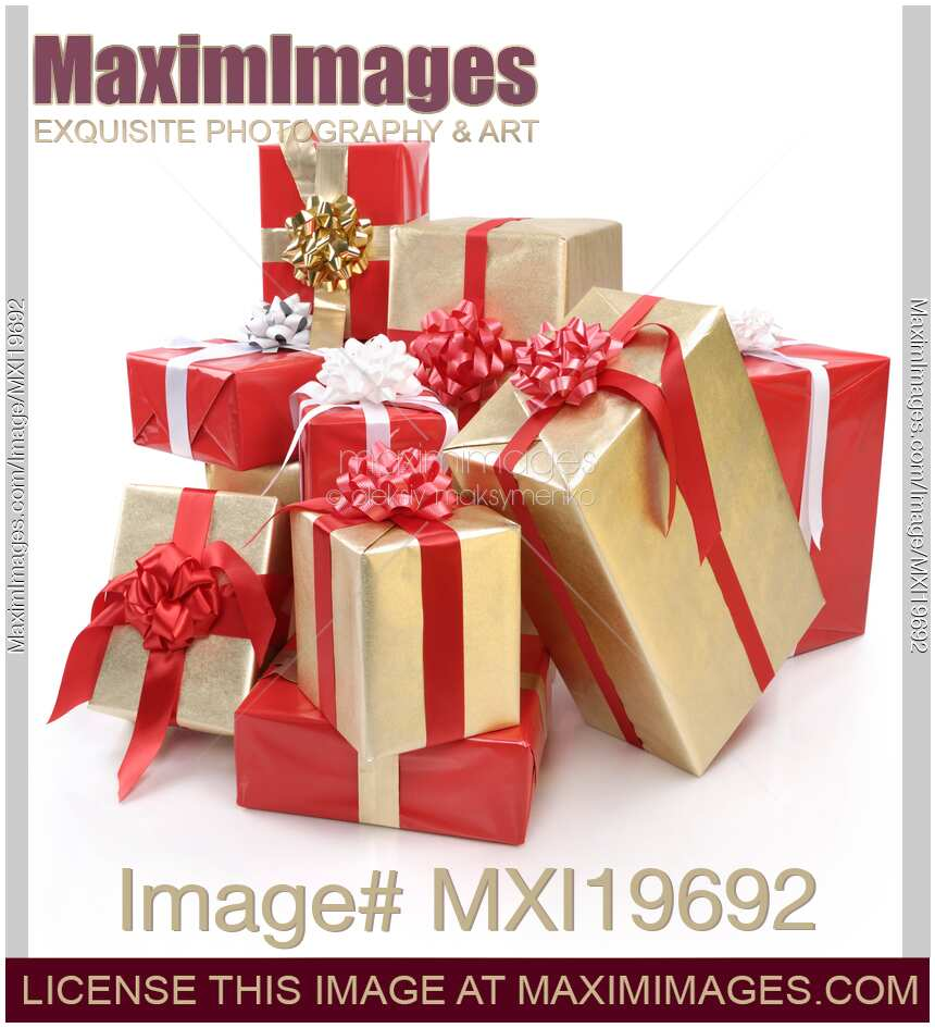 Stock photo: Pile of Christmas gifts wrapped in red and gold ...