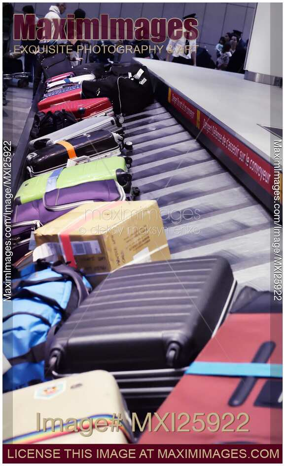 stock photo row of suitcases on airport baggage claim. Black Bedroom Furniture Sets. Home Design Ideas