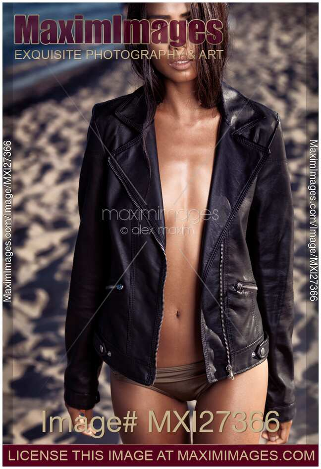 Stock Photo Sexy Young Woman At The Beach Wearing Black Leather Jacket  Maximimages -3358