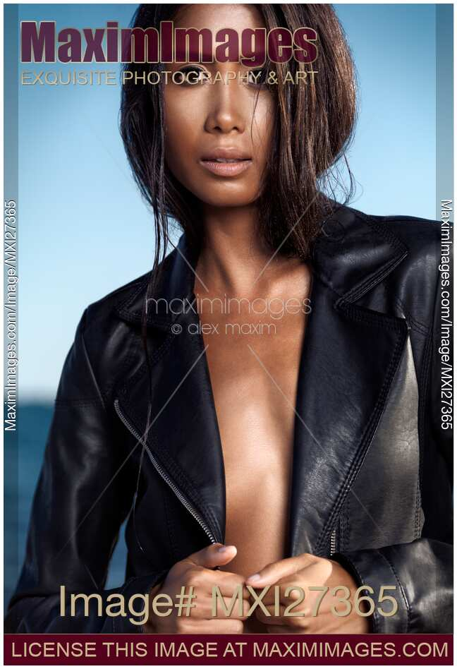 Stock Photo Sexy Young Woman In Black Leather Jacket On Shiny Bare Skin  Maximimages -1339