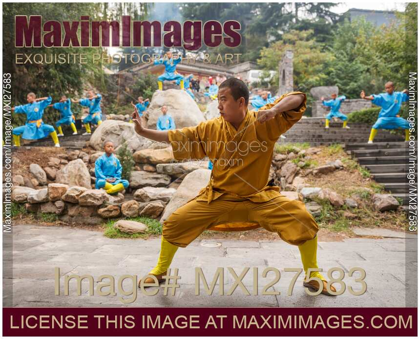 Shaolin martial arts school instructor and students practicing Qi Gong outside