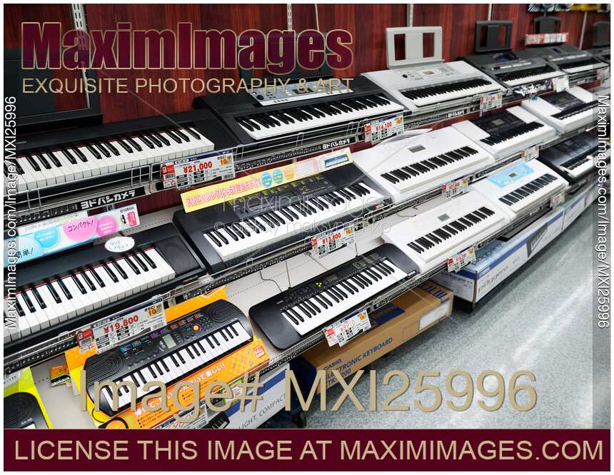 Photo of Synthesizers keyboards on store display | Stock Image MXI25996