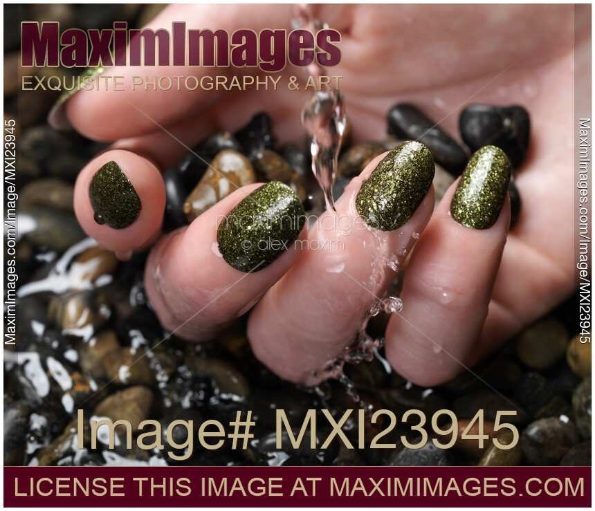Stock photo: Woman Hand With Fancy Nail Polish in Water ...