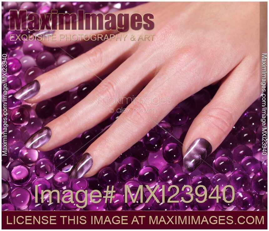 Nail Polish Colors For Younger Looking Hands: Stock Photo: Woman Hand With Purple Nail Polish