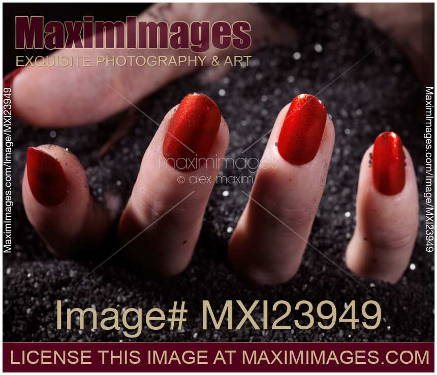 Nail Polish Colors For Younger Looking Hands: Stock Photo: Woman Hand With Red Nail Polish Buried In