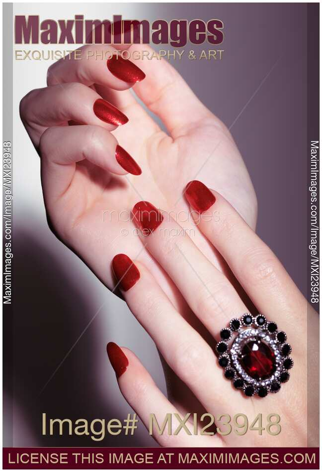 Stock Photo Of Woman Hands With Red Nail Polish And A Ring
