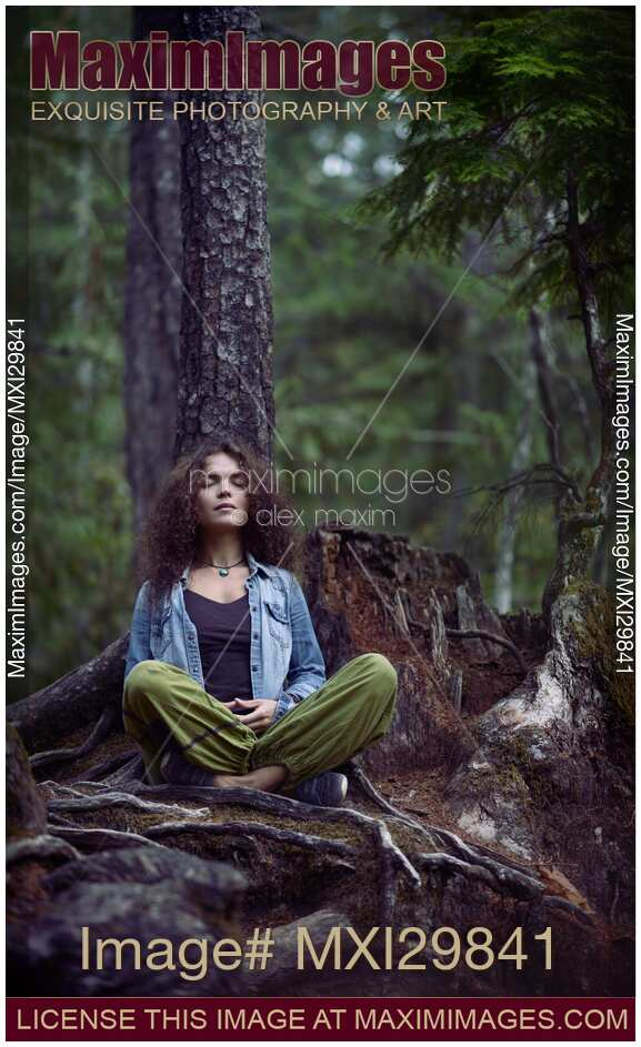 Young Woman Meditating In A Forest. Zen, Meditation