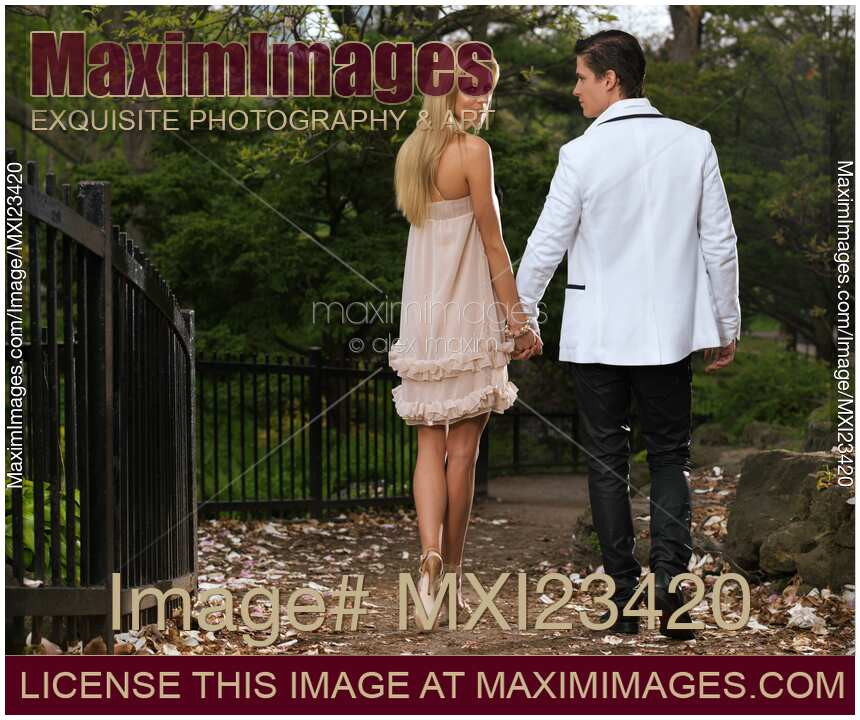 stock photo young couple walking in a park maximimages