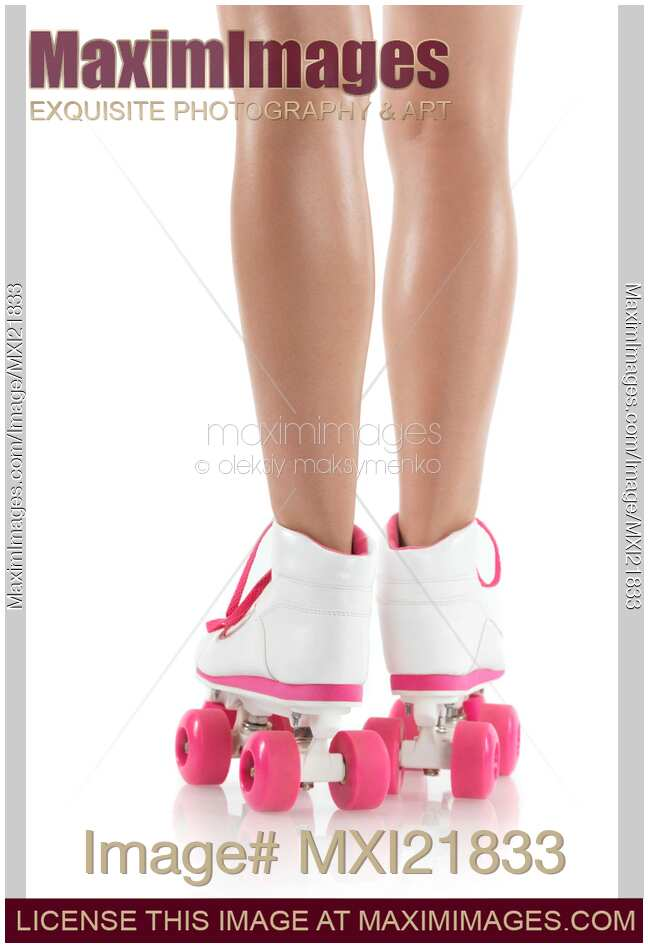 Stock photo of Young Woman Wearing Roller Derby Skates