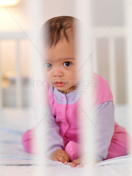 341e5c0c7c5 This Rights-Managed stock photo of Baby Girl in a Crib by Alex Maxim