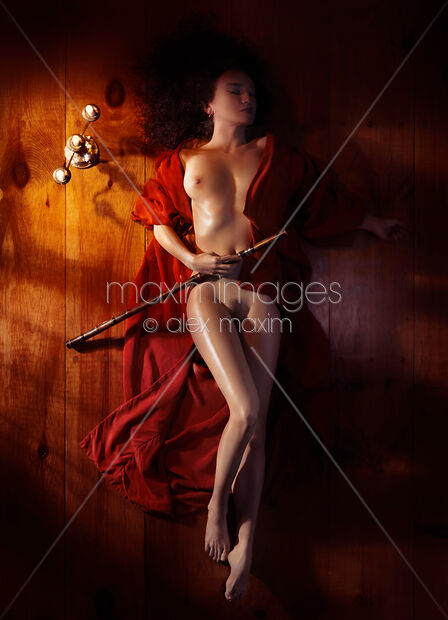 Beautiful nude woman in red kimono lying on floor