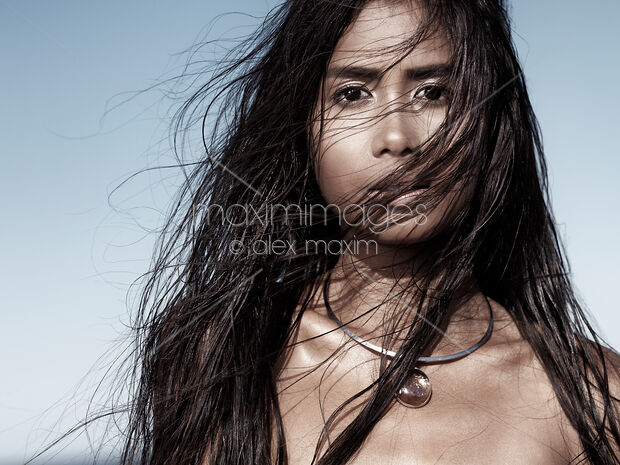 Beautiful woman with long wet hair artistic portrait