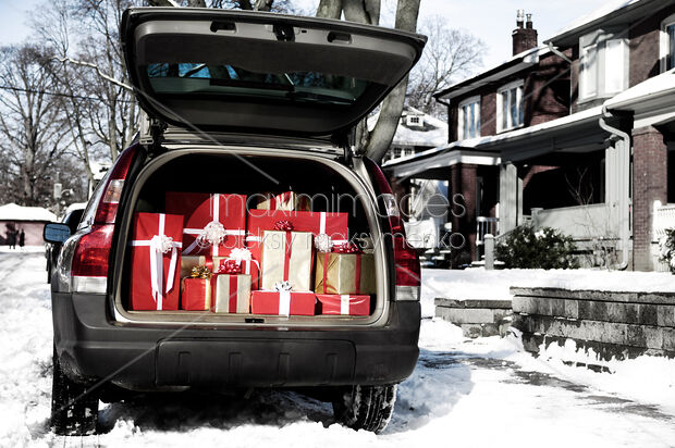 Photo of Car with open trunk full of gift boxes Christmas ...