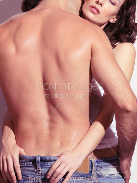 This Rights-Managed stock photo of Closeup of a woman embracing a man with bare torso by Alex Maxim, is available for commercial, editorial or personal usage. You can buy a license of this image at MaximImages.com.