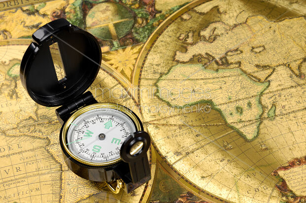 Stock Photo of Compass on a World Map Image MXI20689 at MaximImages.com
