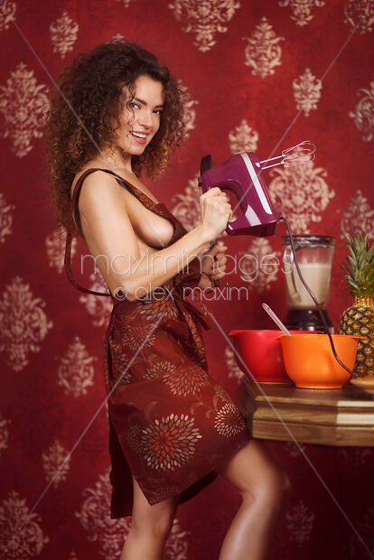 Stock Photo Of Cute Sexy Playful Woman In The Kitchen Wearing Apron Over Naked Body Holding A Image MXI31367 At