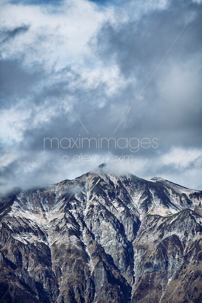 Photo of Dramatic atmospheric scenery of Mount Kasa peak Kasa-ga-take Japan Northern Alps