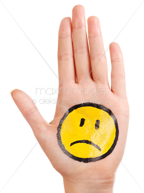 Stock Photo of Hand with a sad smiley face icon on it Image MXI24598 at  MaximImages com