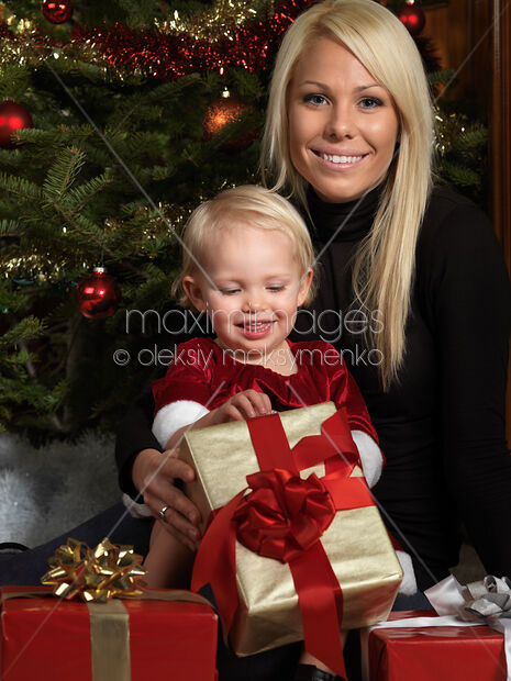 Stock photo: Mother and Daughter Opening Christmas Gifts ...