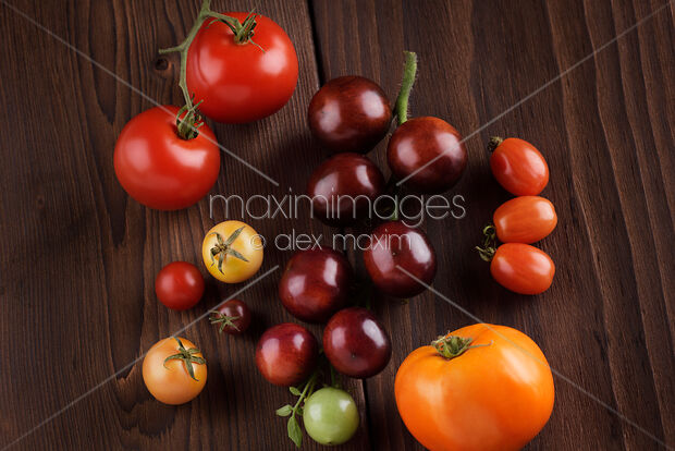 Photo Of Organic Heirloom Tomatoes Of A Variety Of Sizes And