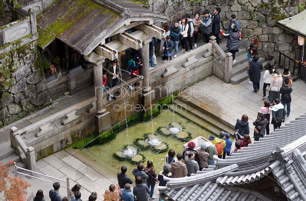 People at Otowa sacred waterfall in Kiyomizu-dera Otowa-no-taki Kyoto