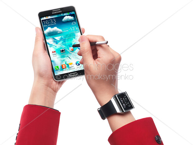 Person with Samsung Galaxy Note III smartphone and Galaxy Gear watch